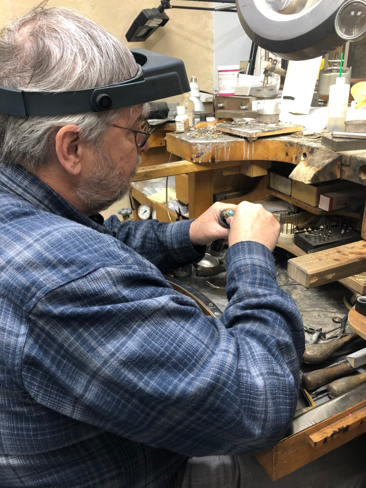 Tom Gould working at his goldsmithing bench
